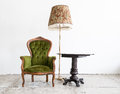 Green classical style Armchair sofa couch in vintage room with d Royalty Free Stock Photo