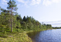 Green coast of blue lake. Kola Peninsula Royalty Free Stock Photography
