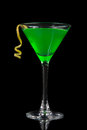 Green cocktail with absinth in martini glass for halloween night Royalty Free Stock Photo