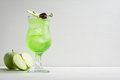 Green cocktail with apple slice Royalty Free Stock Photo