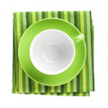 Green coffee cup over kitchen towel view from above isolated on white background Royalty Free Stock Image
