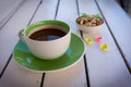 Green coffee cup on white wooden table Royalty Free Stock Photo