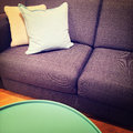Green coffee table and sofa with cushions Royalty Free Stock Photo
