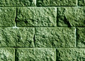 Green color stylized brick wall pattern.