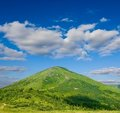 Green conical mountain Stock Photo
