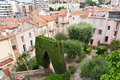 The green corner small park is sandwiched between old houses cannes france Royalty Free Stock Images