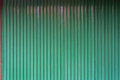 Green corrugated metal texture with red tab Royalty Free Stock Photo