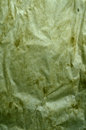 Green creased paper crumpled abstract background Stock Photo