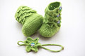 Green crochet baby booties with head band,  on white, crocodile stitch booties Royalty Free Stock Photo