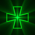 Green cross with bright light flare st george s star decoration in the middle shining powerful halo Stock Image