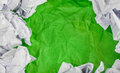 Green Crumpled paper background with crumpled paper ball Royalty Free Stock Photo