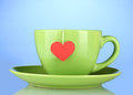 Green cup with saucer and tea Royalty Free Stock Photography