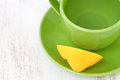 Green cup water lemon old board Stock Image