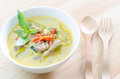 Green curry with pork and fork spoon on wood table Royalty Free Stock Photo