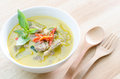 Green curry with pork and fork spoon on wood table Stock Photo