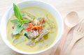 Green curry with pork and fork spoon on wood table Stock Image