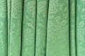 Green curtain retro as a textured background Stock Photos
