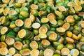 Green cut tangerine peels rings texture background close up, many fresh squeezed orange mandirins rinds, sliced citrus fruits