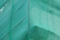 Green debris netting under construction building covered with Stock Photo