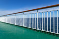 Green deck of a passenger ship with sea and blue sky in the background Royalty Free Stock Photography