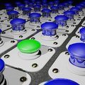 Green depressed pushbutton among blue ones Royalty Free Stock Photos