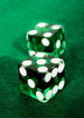 Green dices over felt Royalty Free Stock Image