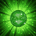 Green disco ball and light burst Stock Photography