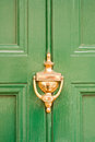 Green door with brass knocker Royalty Free Stock Photo