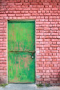 Green door and brick wall Stock Photos