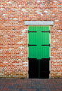 Green Door in a Brick Wall Royalty Free Stock Image