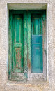 Green door with broken glass Royalty Free Stock Photo