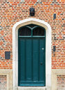 Green door with windows Royalty Free Stock Image