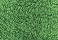 Green double sided terry towelling fabric texture background.