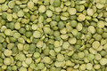 Green dry purified peas closeup top view background. Royalty Free Stock Photo