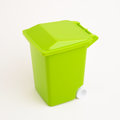 Green dumpster on uniform background Stock Photography