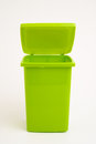Green dumpster on uniform background Royalty Free Stock Photo