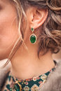 Green earring in the ear women Royalty Free Stock Images