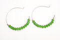 Green earrings fashion jewelery set on white background Stock Image