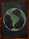 Green earth on blackboard globe background Royalty Free Stock Photos