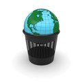 Green Earth in the trash Royalty Free Stock Image