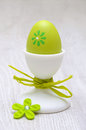 Green easter egg in egg-cup Royalty Free Stock Photos