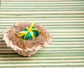 Green Easter egg in a straw hat Stock Image