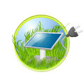 Green eco logo of solar panel in grass Stock Images