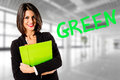 Green economy smiling happy business woman in her office for Royalty Free Stock Image