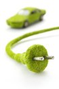 Green electric plug with eco car icon Royalty Free Stock Images