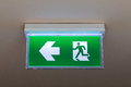 Green emergency exit sign Royalty Free Stock Photo