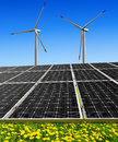 Green energy concepts solar panels and wind turbines Royalty Free Stock Photo