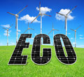 Green energy concepts solar panels and wind turbines on meadow Royalty Free Stock Photography