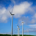 Green energy producer windfarm over the blue sky Royalty Free Stock Photography