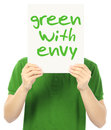 Green with envy a young man holding a poster indicating Stock Image